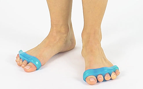 woman's feet wearing toe separators while standing