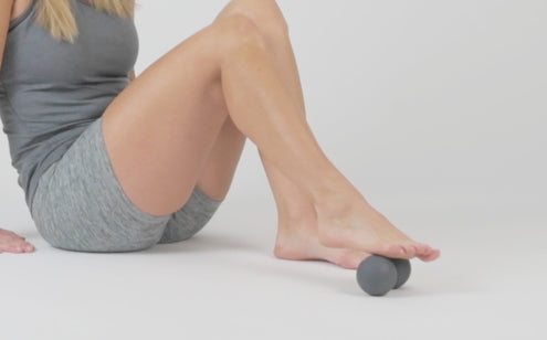 Massaging foot with peanut massage ball