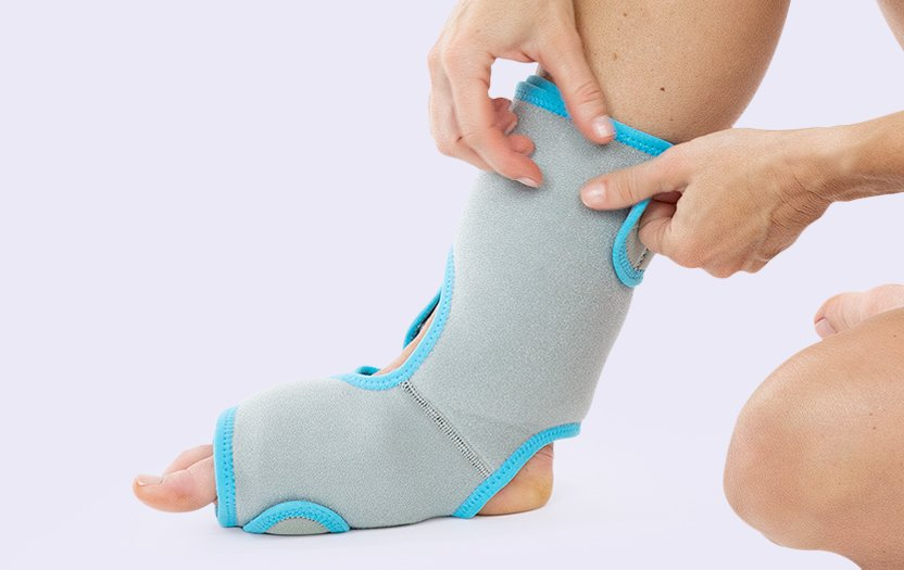 Right foot wearing ankle ice pack
