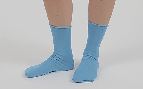 woman wearing non slip hospital socks