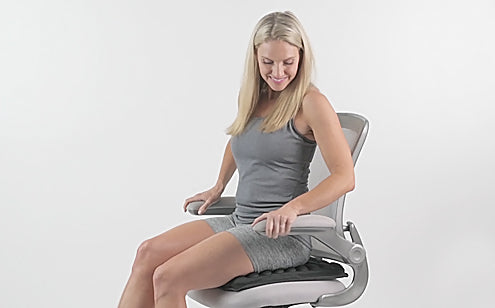 Happy woman sitting in a chair with max gel seat cushion