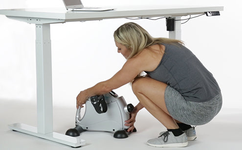 Placing pedal exerciser under the table