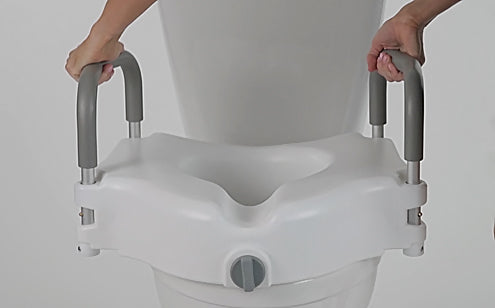person installing raised toilet seat