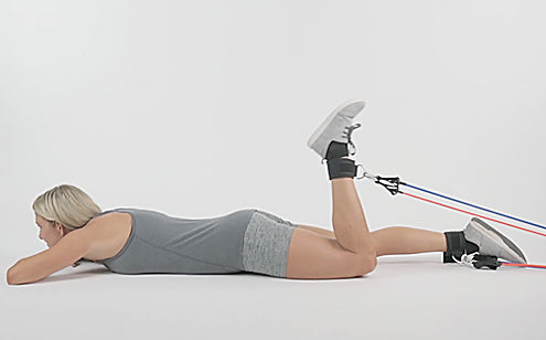 woman exercising legs with resistance bands