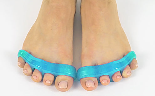 woman's feet wearing blue toe separators