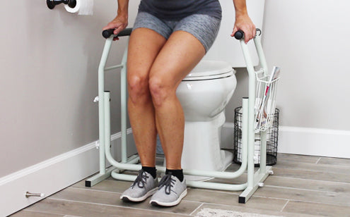 Holding stand alone toilet rail