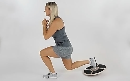 lunge exercise with wooden balance disc