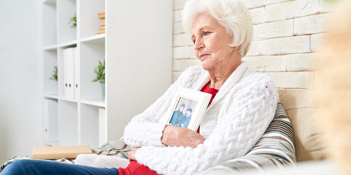 Senior woman sitting at home alone in armchair