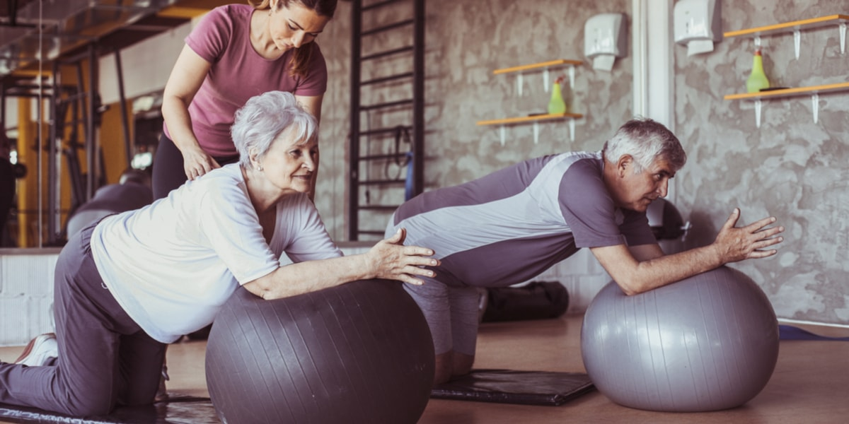 Senior people on pilates ball