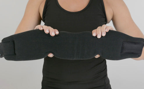 Woman holding a soft flexible foam neck brace