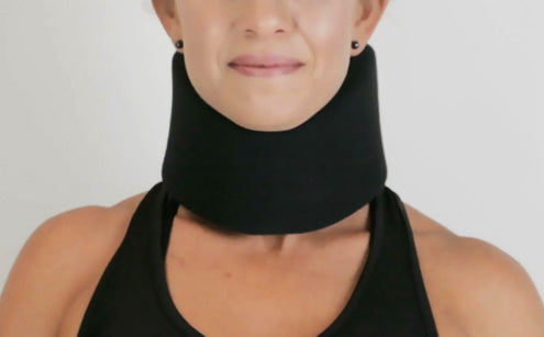 Middle age woman wearing black neck brace