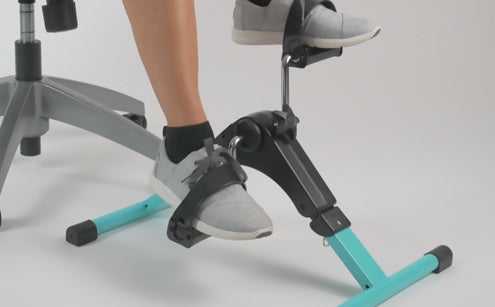 Using pedal exerciser while sitting