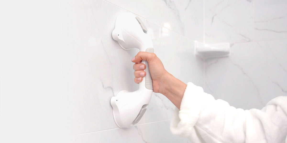 Hand holding suction grab bar by vive
