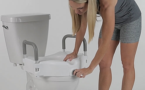 woman adjusting locking screw to install raised toilet seat