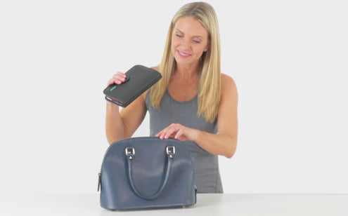 Middle age woman putting Leather Case in the bag