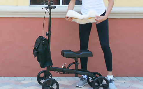 Woman inserting knee pad cover to the knee walker
