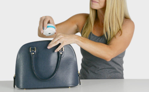 Woman holding a massage roller ball to put in the bag