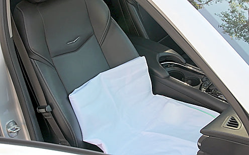 Car seat placed with reusable incontinence pad