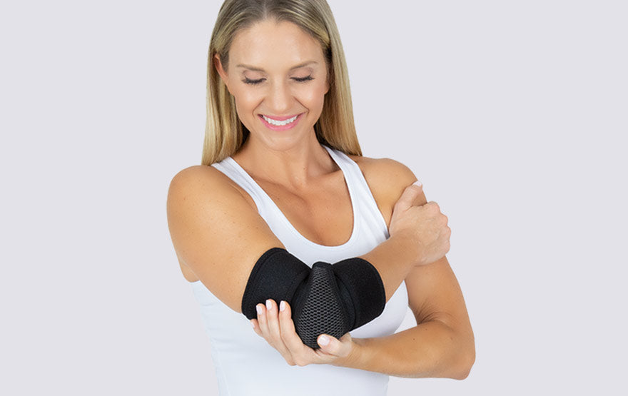 Woman wearing elbow brace
