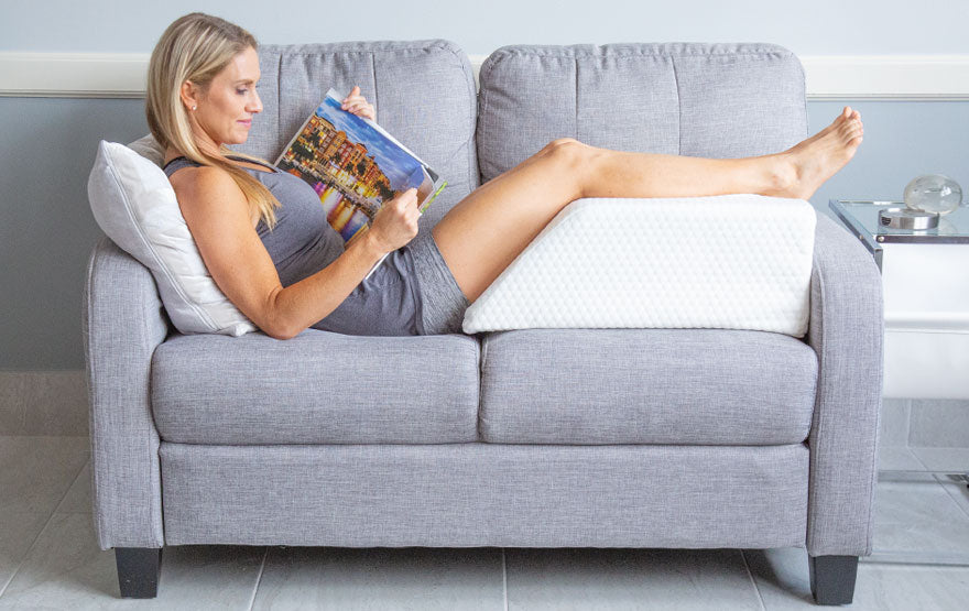 woman using leg rest pillow