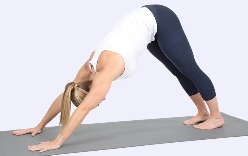 Woman performing a pose on a yoga mat