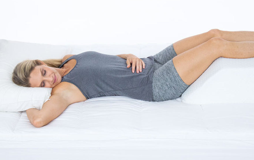Woman sleeping elevated leg
