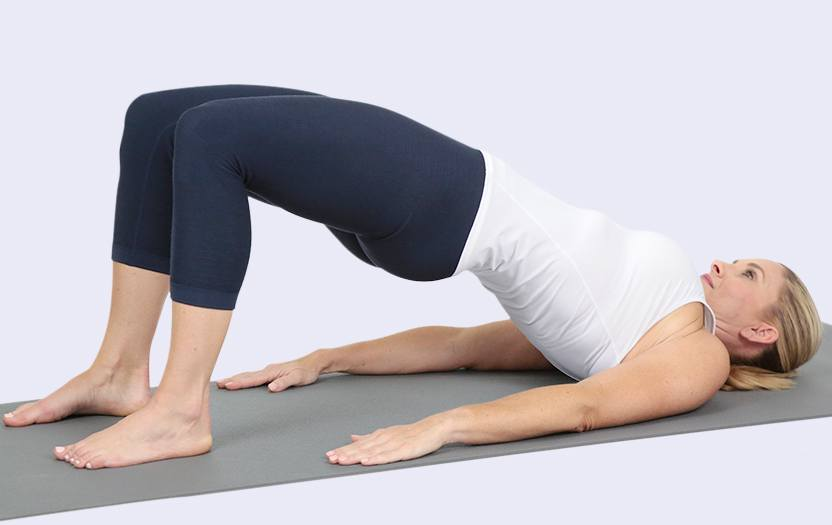 Woman stretching her back on a yoga mat