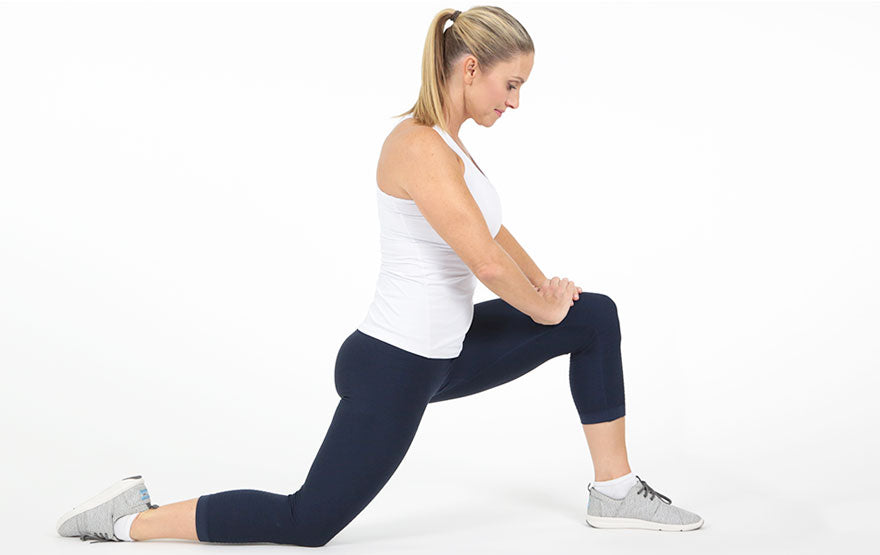 Woman stretching thigh