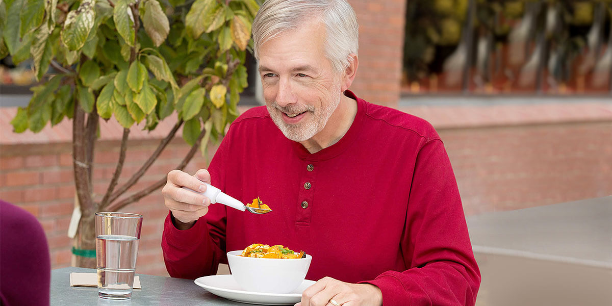 elderly man eating