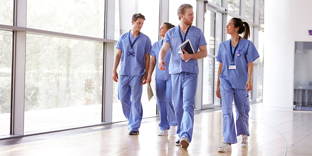 group of nurses walking