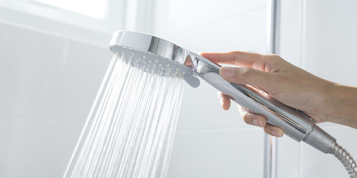 Holding A Shower Head. Using Shower Heads For Low Water Pressure ...