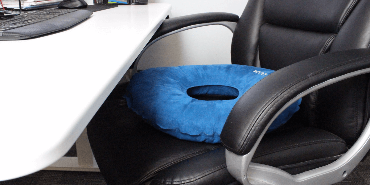 inflatable donut cushion on desk chair
