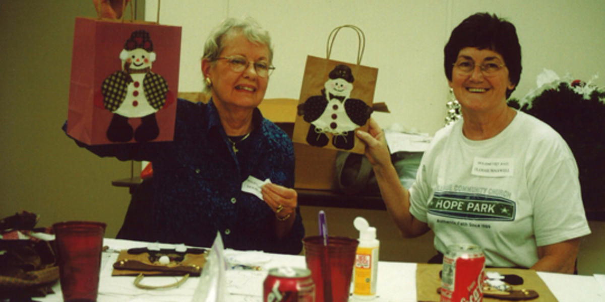two women making gift bags