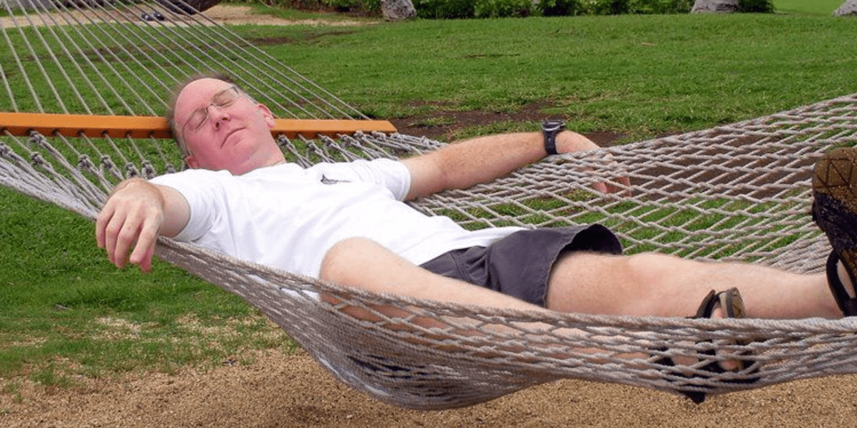 man relaxing in hammock