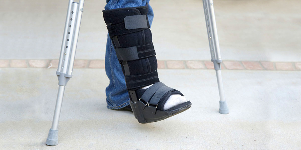 man wearing a boot for a broken foot