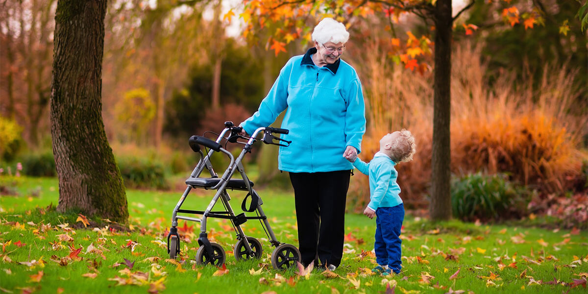 old lady with walker rollator along with her grandson