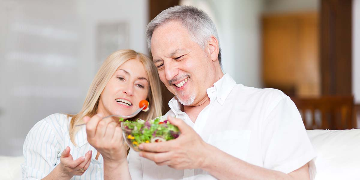 senior couple happy eating salad
