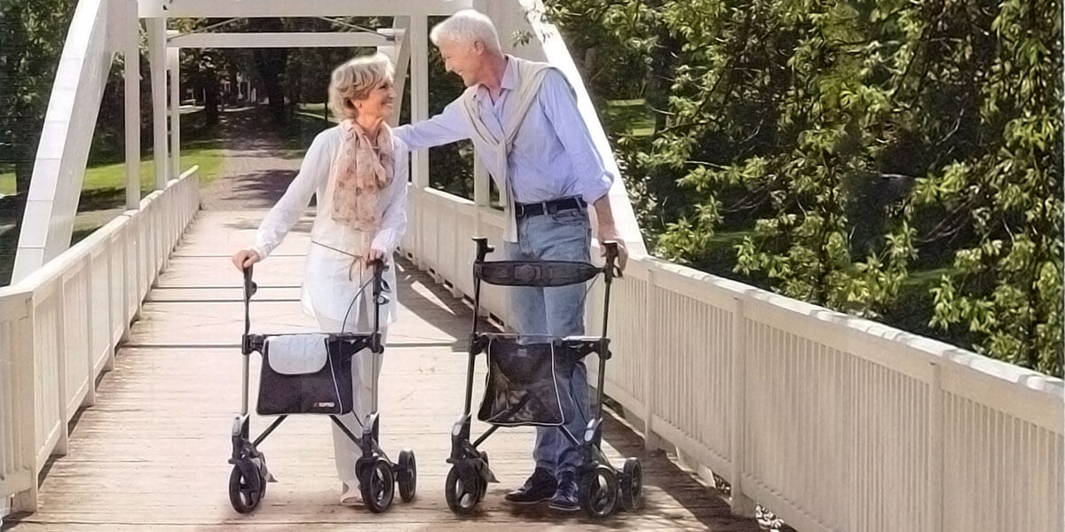 senior couple with walker rollators