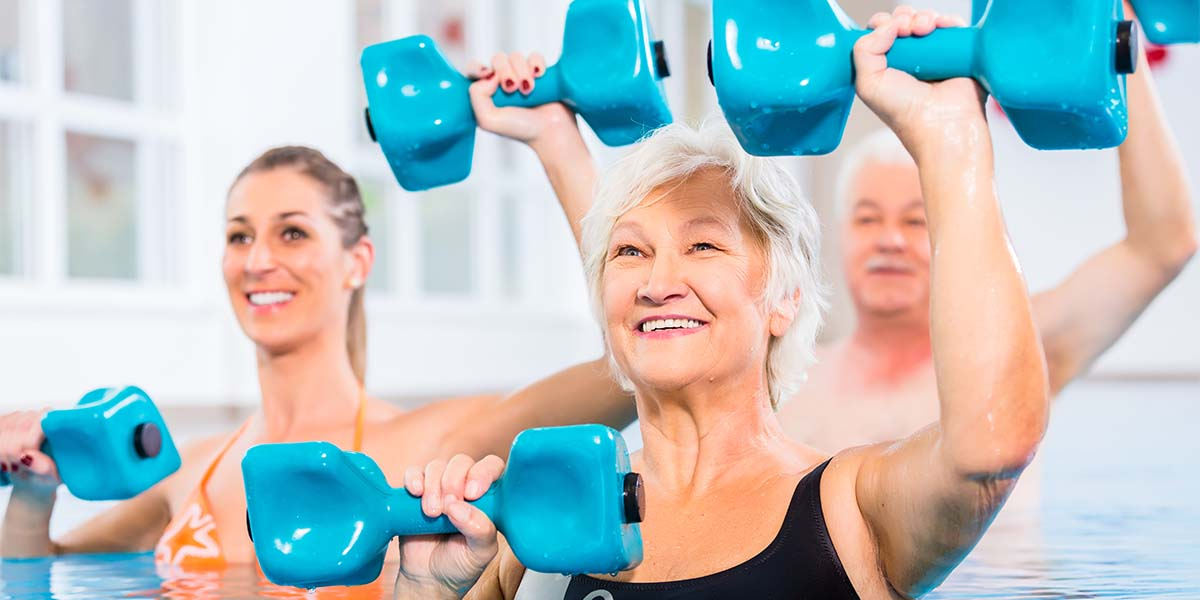 seniors with dumbbells water exercise