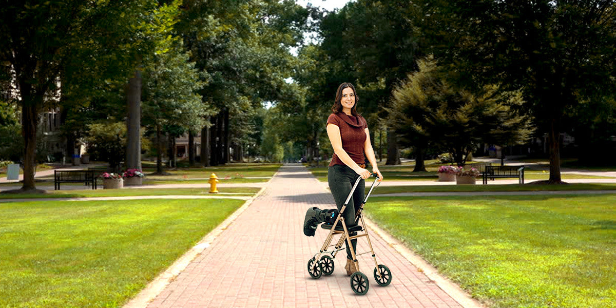 woman using knee scooter outside