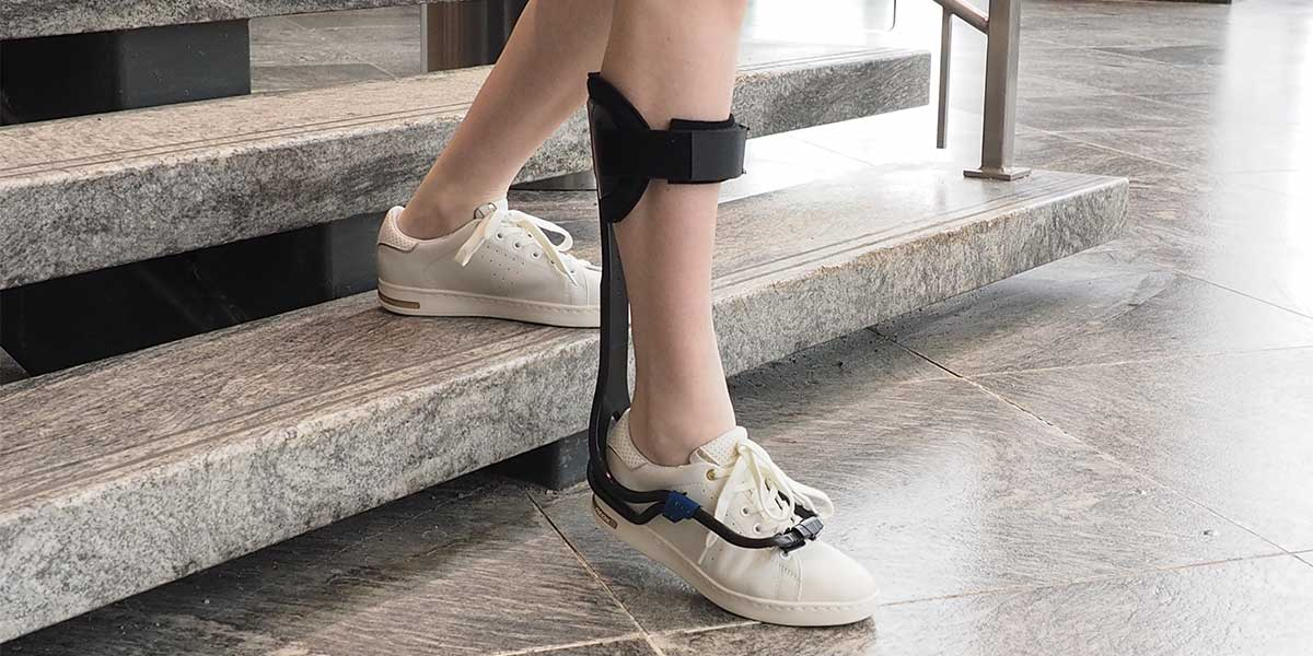 woman wearing drop foot brace
