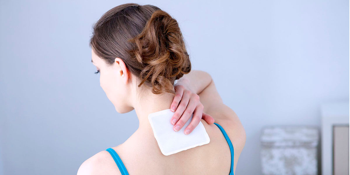 woman with pain relief patch at her back