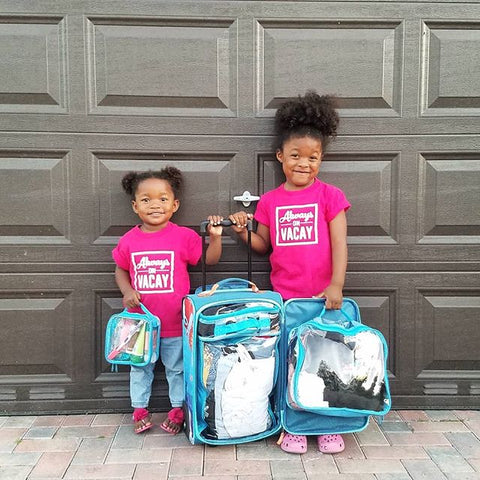 Daughters of Monet Hambrick with turquoise packing cubes