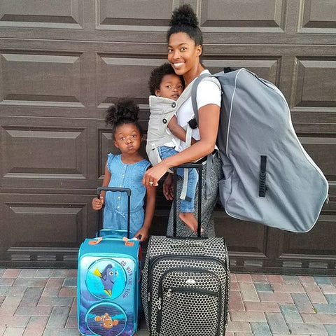 Monet Hambrick with daughters and luggage