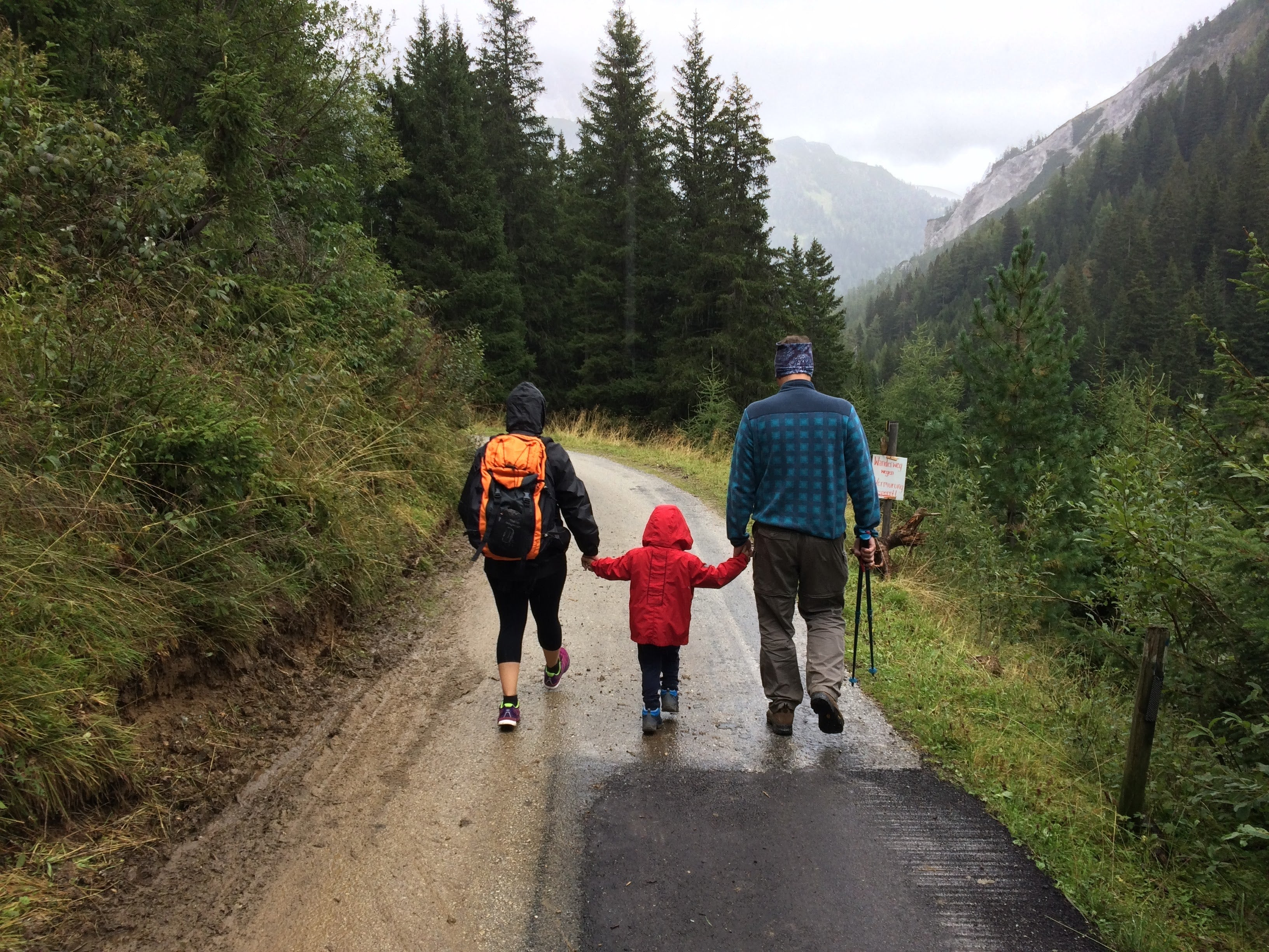 Parents traveling with their kid in the mountains