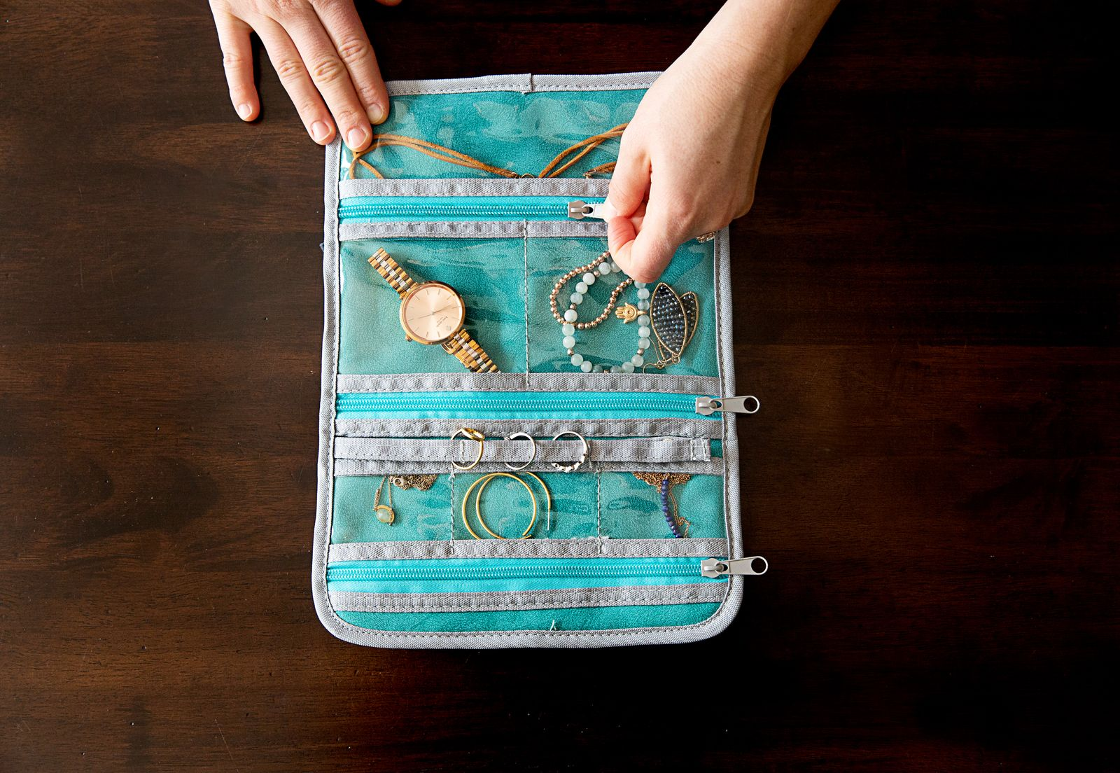 Accessories organized in a travel jewelry roll