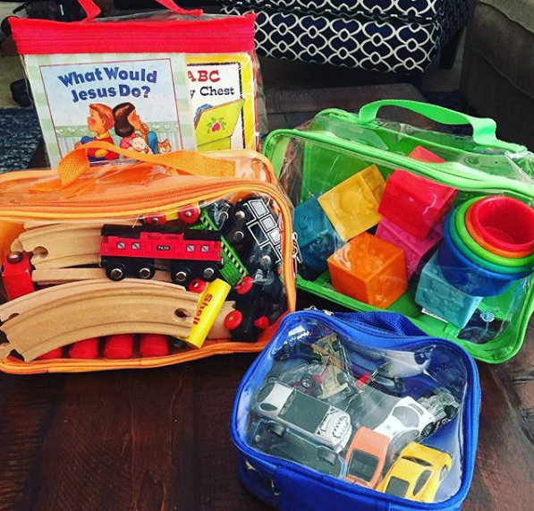 Activity Kit for kids organized in packing cubes for an RV camping trip
