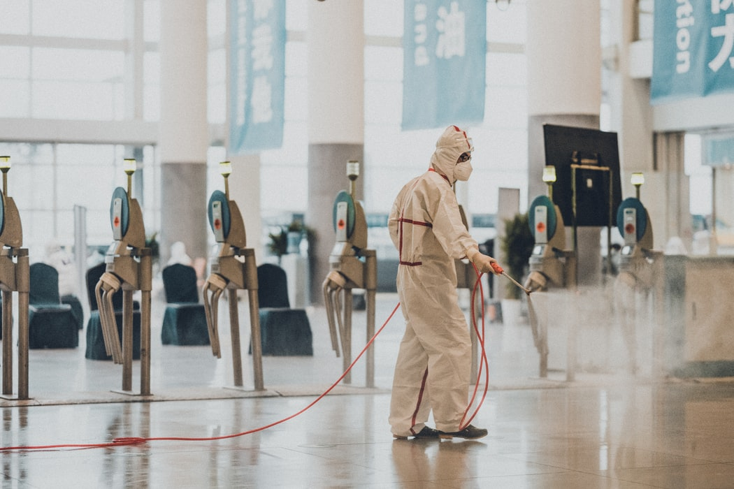 Man sanitizing airport