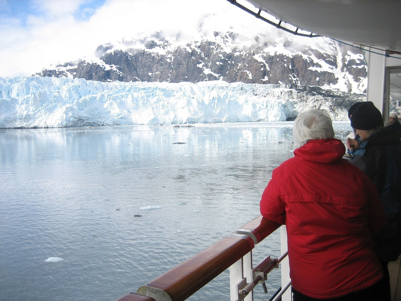 Woman wearing waterproof jacket on Alaska cruise