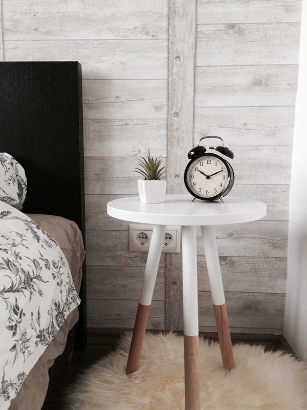 Alarm clock on white bedside table